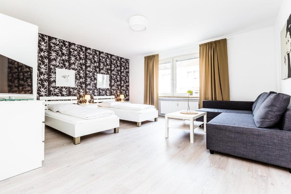 A seating area at Cityfair Apartments Köln