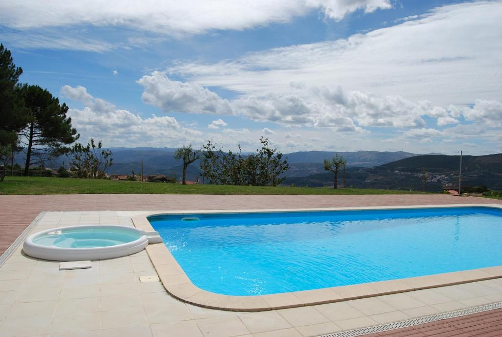 The swimming pool at or close to Quinta Manhas Douro