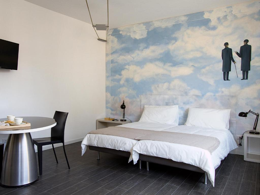 A bed or beds in a room at BnB Hello Milano