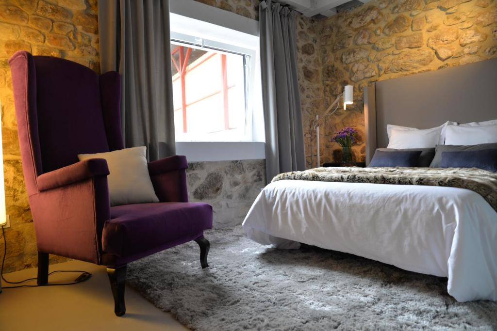 A bed or beds in a room at Garaiko Landetxea