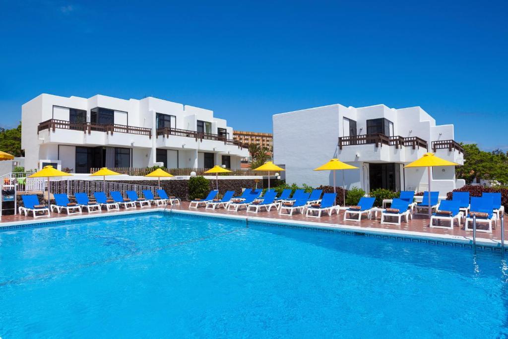 Het zwembad bij of vlak bij Paraiso del Sol