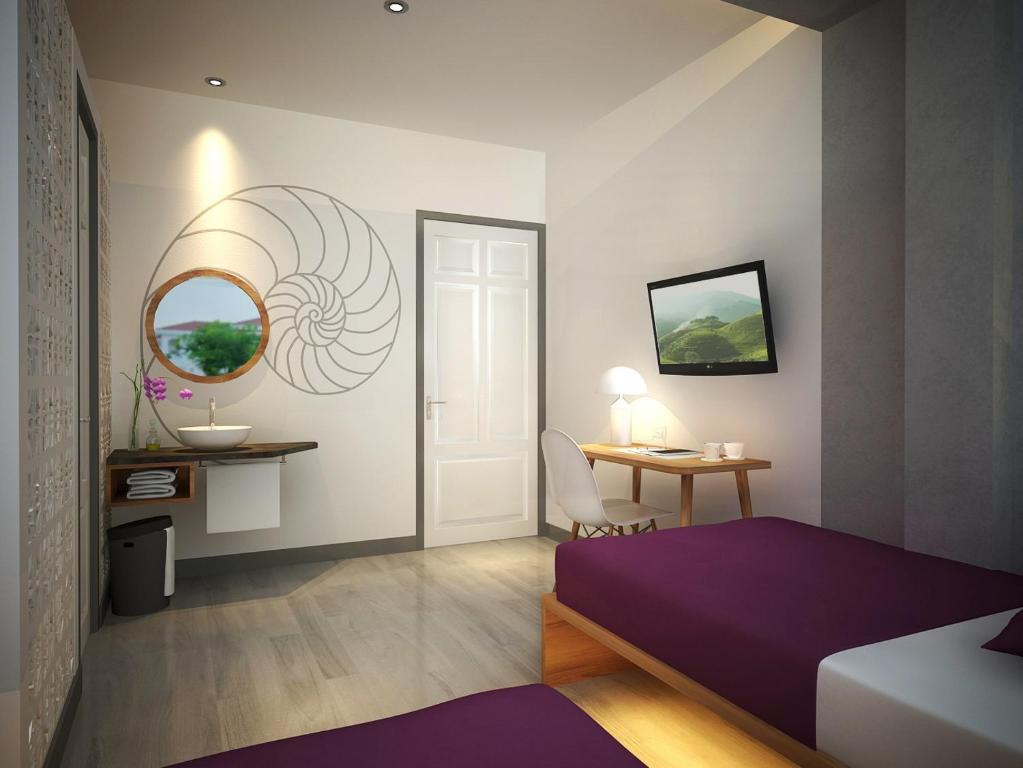 Cama o camas de una habitación en Town House 23 Saigon
