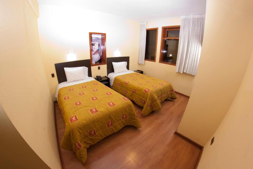Cama o camas de una habitación en Qosqo Wasi
