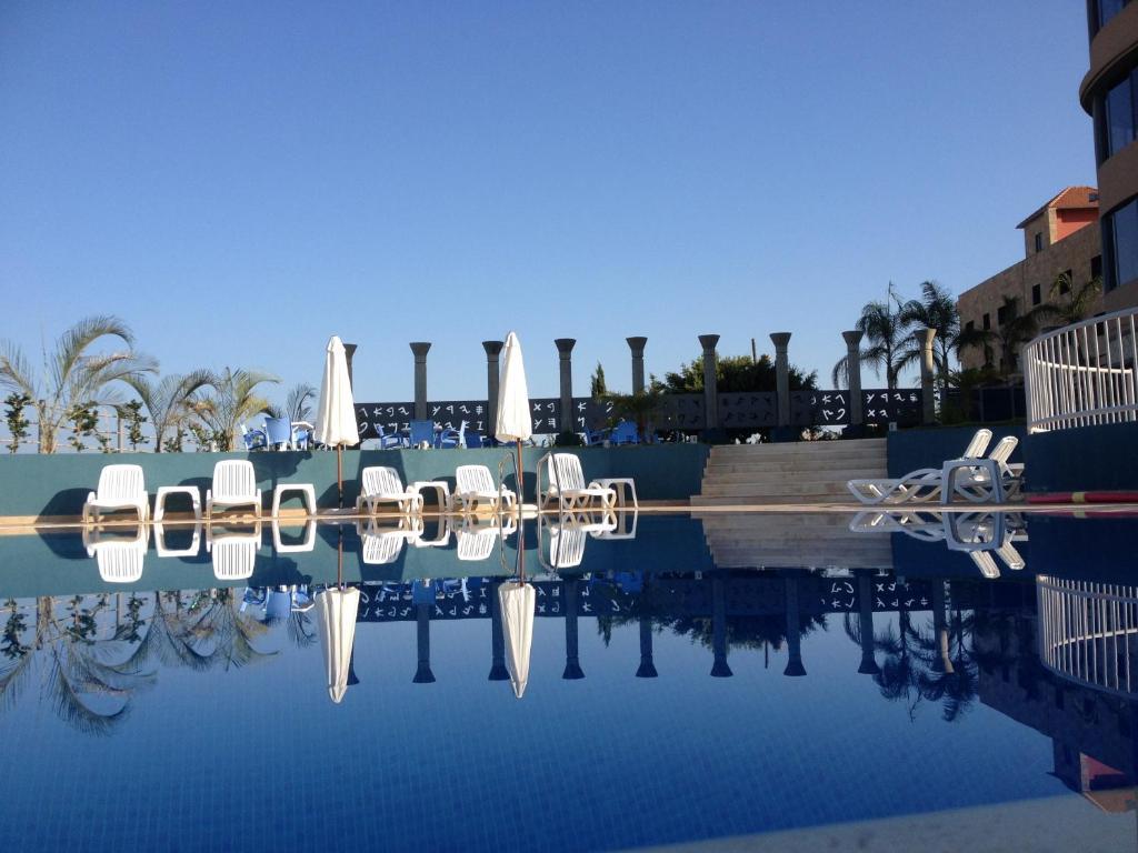 The swimming pool at or near L'Hotel De Mon Pere