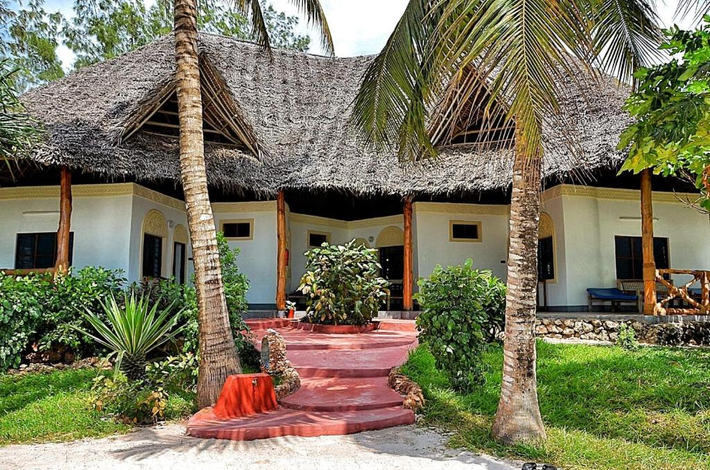 A porch or other outdoor area at Pongwe Beach Hotel