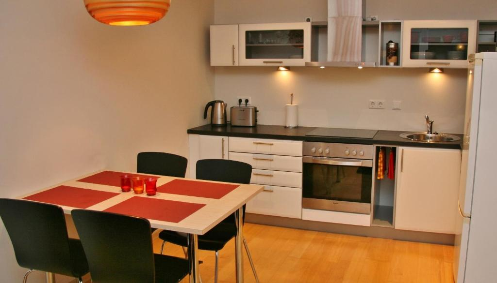 A kitchen or kitchenette at Kuressaare Holiday Apartments