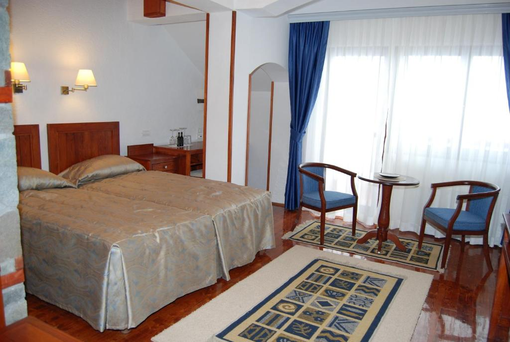 A bed or beds in a room at Popova Kula Hotel & Winery