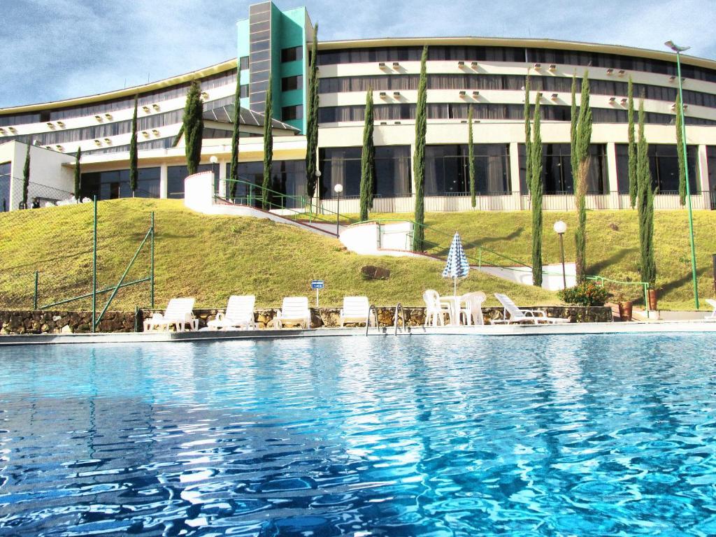 The swimming pool at or near Hotel Golden Park All Inclusive Poços de Caldas