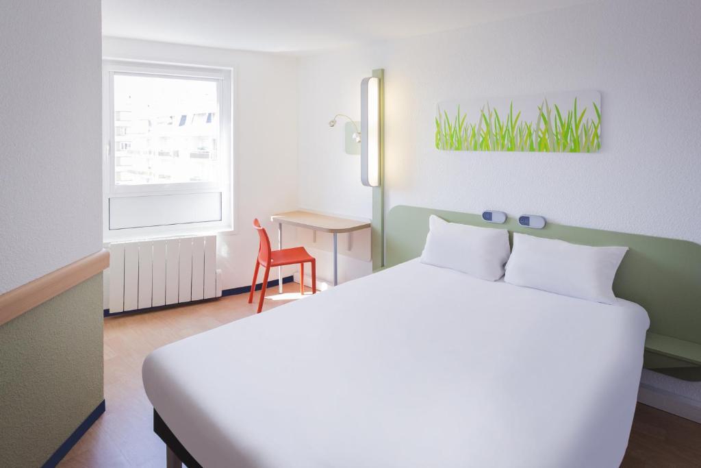 Un ou plusieurs lits dans un hébergement de l'établissement ibis budget Limoges