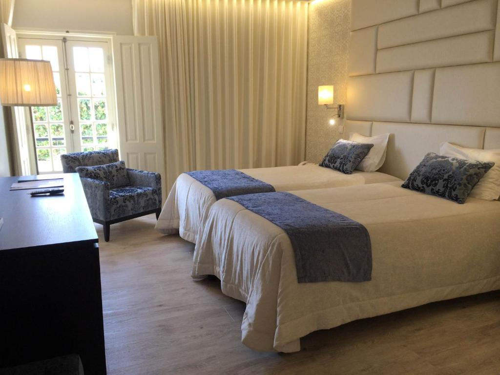 A bed or beds in a room at Josefa D Obidos - Hotel