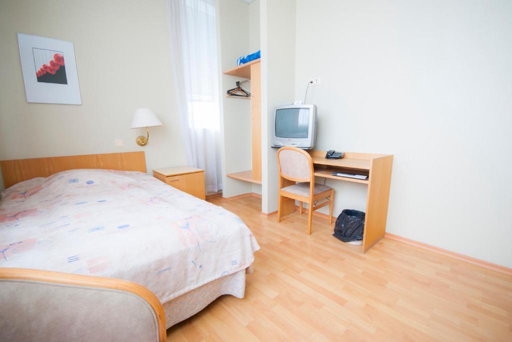 Vuode tai vuoteita majoituspaikassa Tatari 53 Hotel