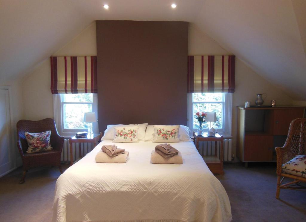 A bed or beds in a room at B&B London Organic