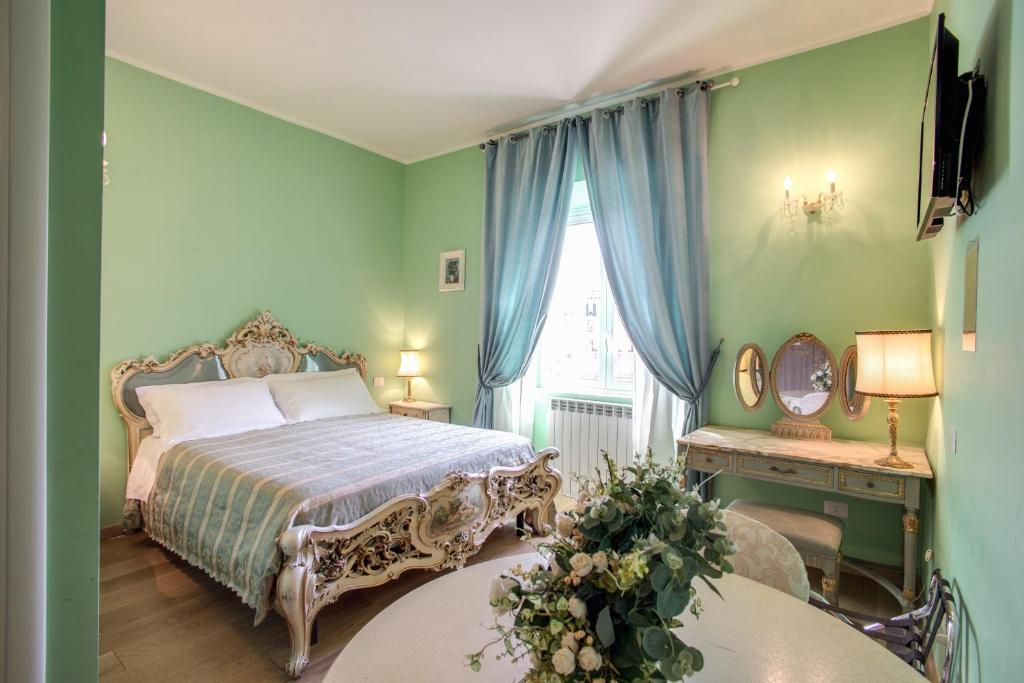 A bed or beds in a room at Residenza Dei Principi