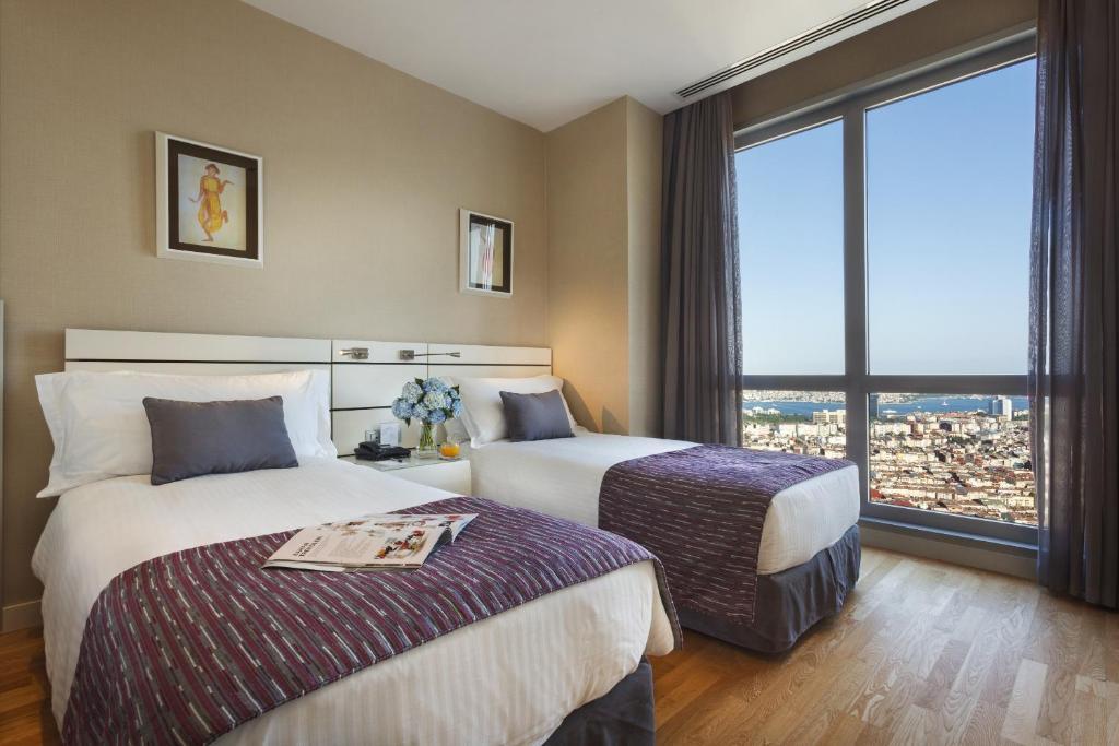 Кровать или кровати в номере Fraser Place Anthill Istanbul