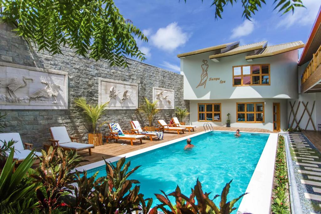 The swimming pool at or near Kaani Village & Spa
