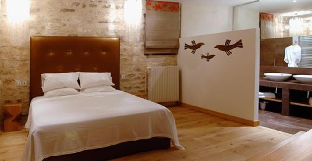 Un ou plusieurs lits dans un hébergement de l'établissement Hotel Du Vieux Moulin