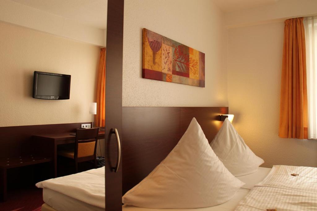 Lova arba lovos apgyvendinimo įstaigoje Haus Sparkuhl Hotel Garni