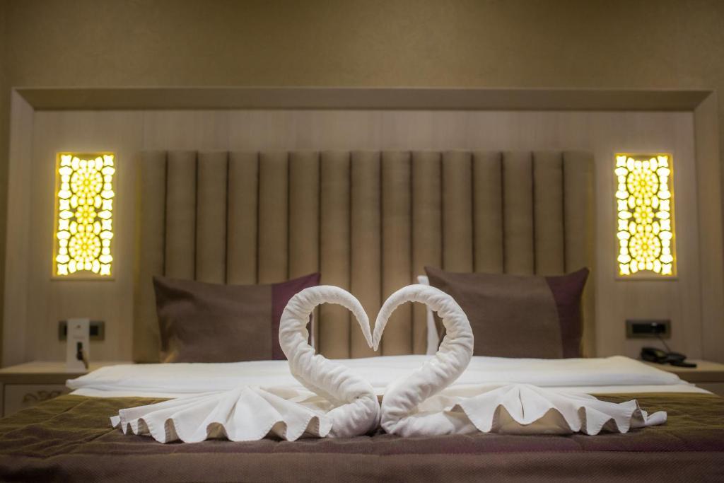 Кровать или кровати в номере Hilly Hotel