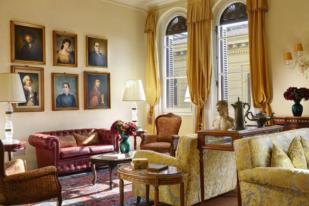 Uma área de estar em Hotel Pendini