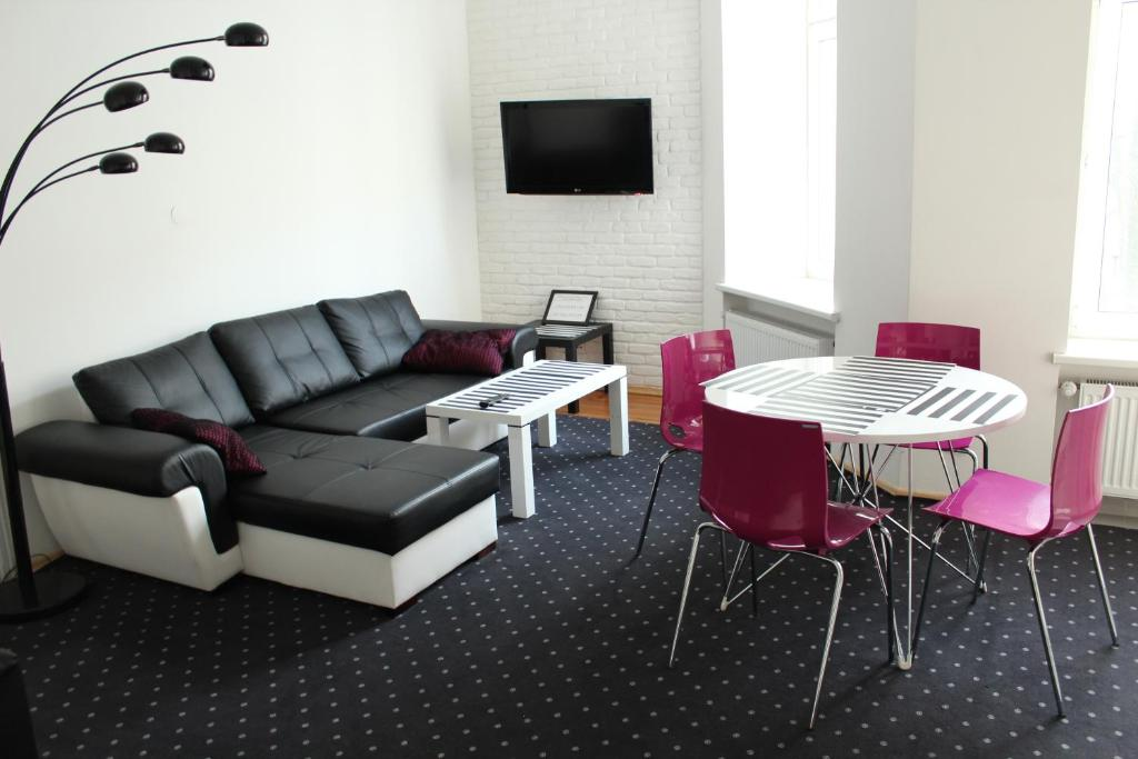 A seating area at Rent-Apart City Center Lodz