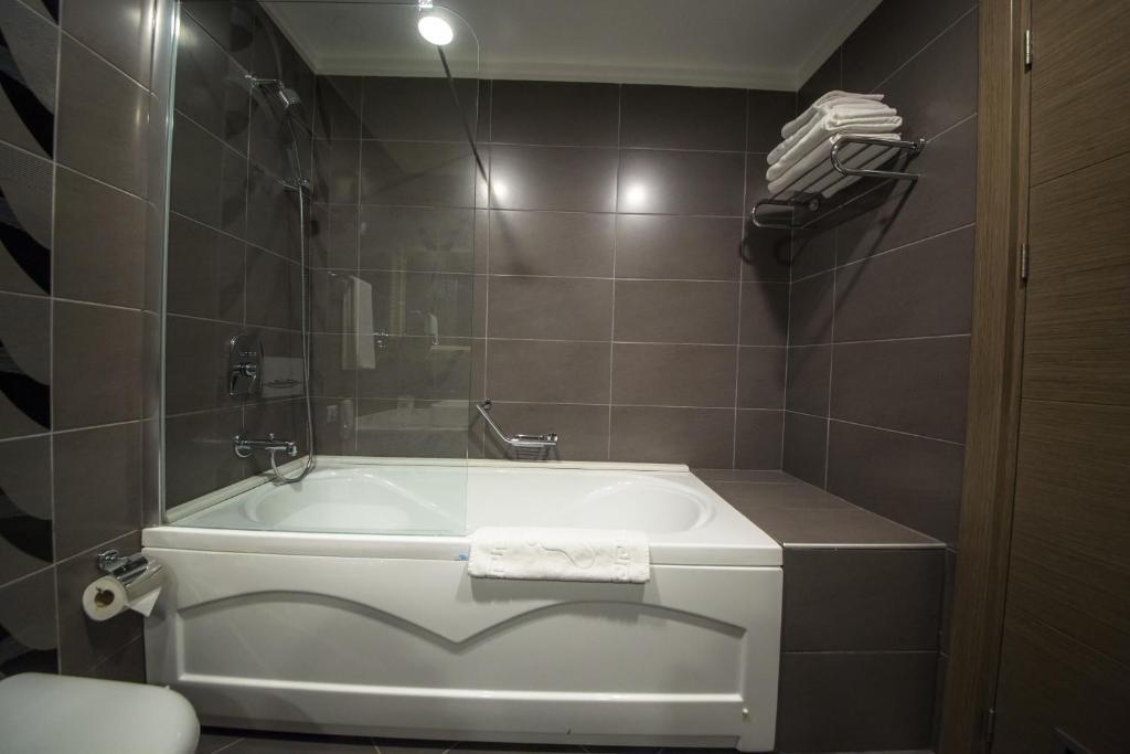 Ванная комната в Hilly Hotel
