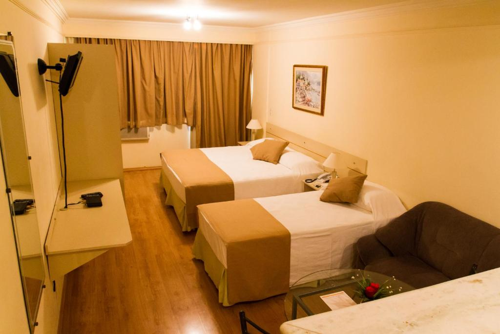 A bed or beds in a room at Harbor Self Buriti Hotel