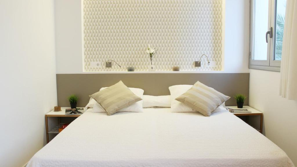 A bed or beds in a room at Residencia Universitaria Torre Girona