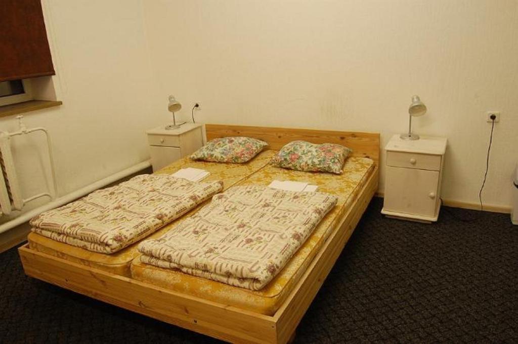 Voodi või voodid majutusasutuse Sports Club Viraaž Hostel toas