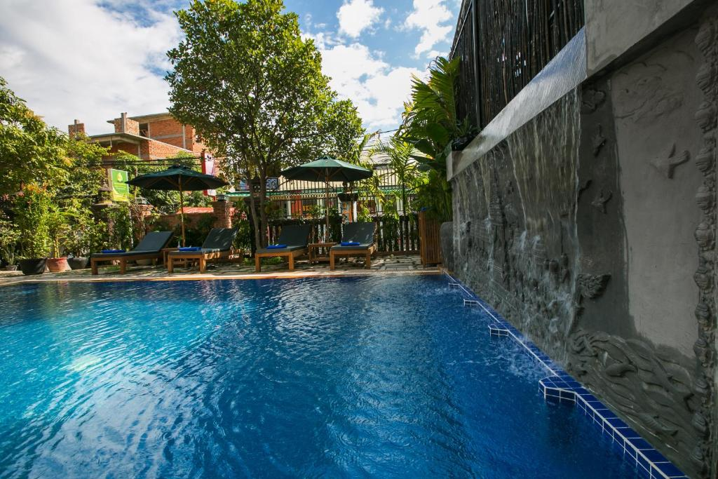 The swimming pool at or close to Friendly Angkor Boutique