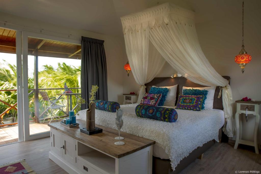 A bed or beds in a room at Bamboo Bali Bonaire
