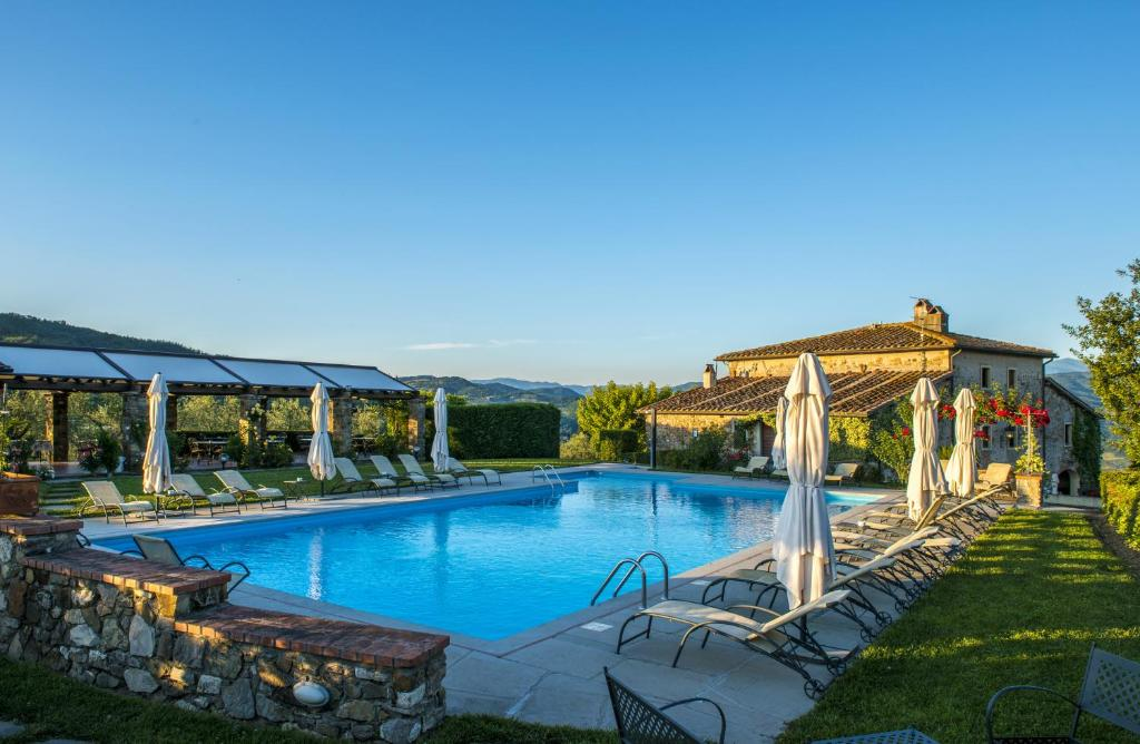 A piscina localizada em Agriturismo Fattoria Lavacchio ou nos arredores