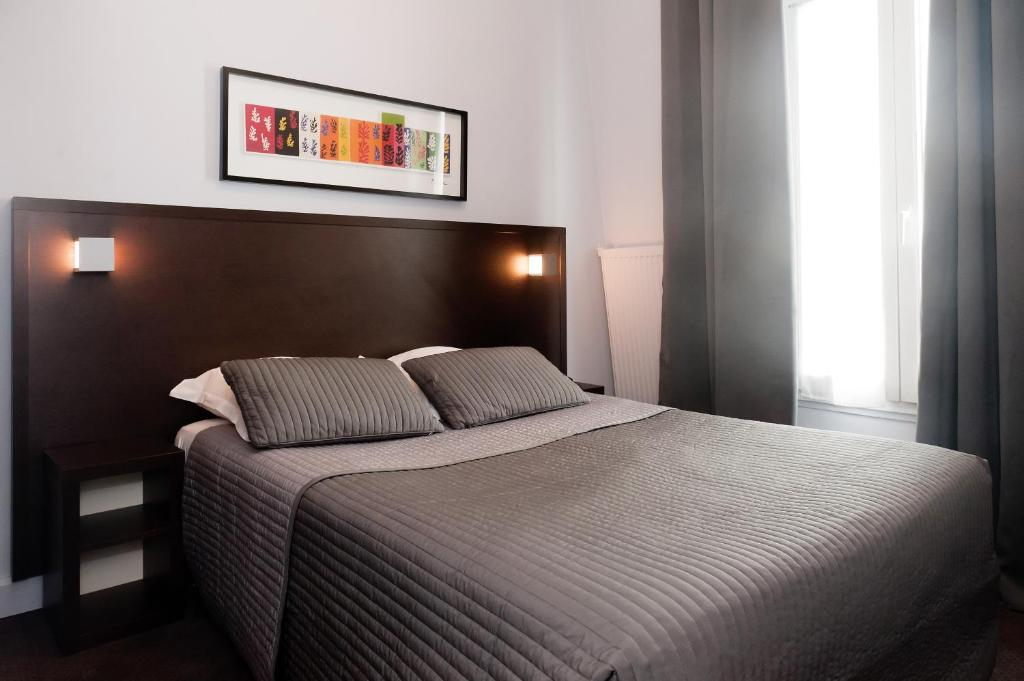Un ou plusieurs lits dans un hébergement de l'établissement Hôtel Odessa Montparnasse