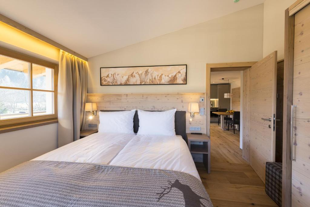 A bed or beds in a room at Alpen Chalet Dorfwies