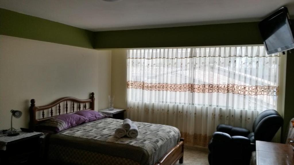 Cama o camas de una habitación en Guest House Mama Sarita