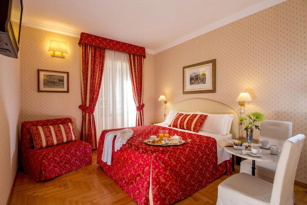 A bed or beds in a room at Boncompagni Suite
