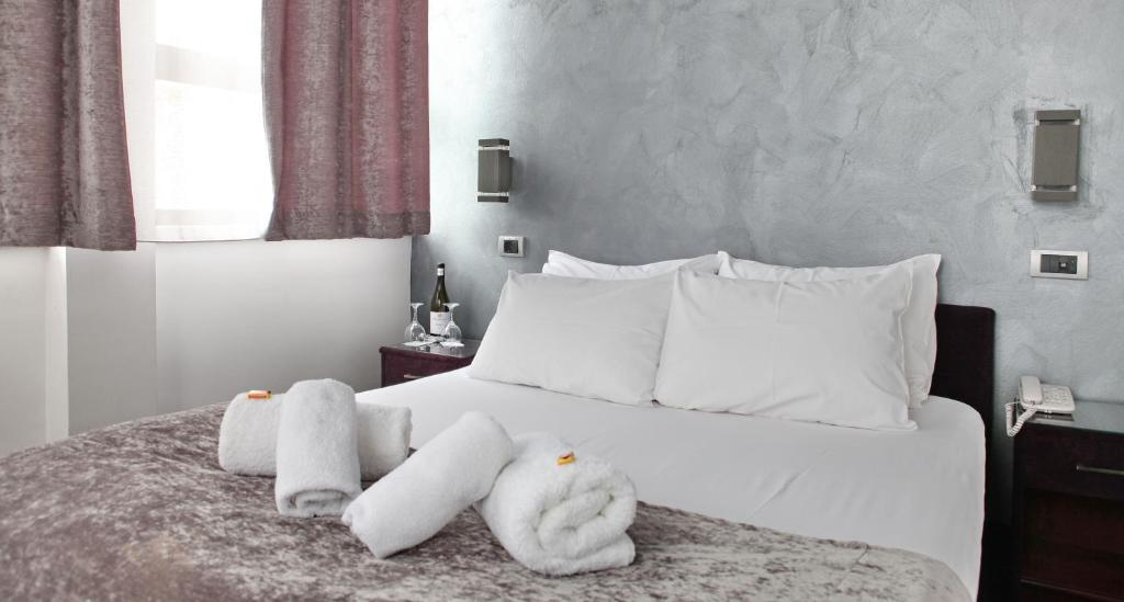 Кровать или кровати в номере Tash Belgrade
