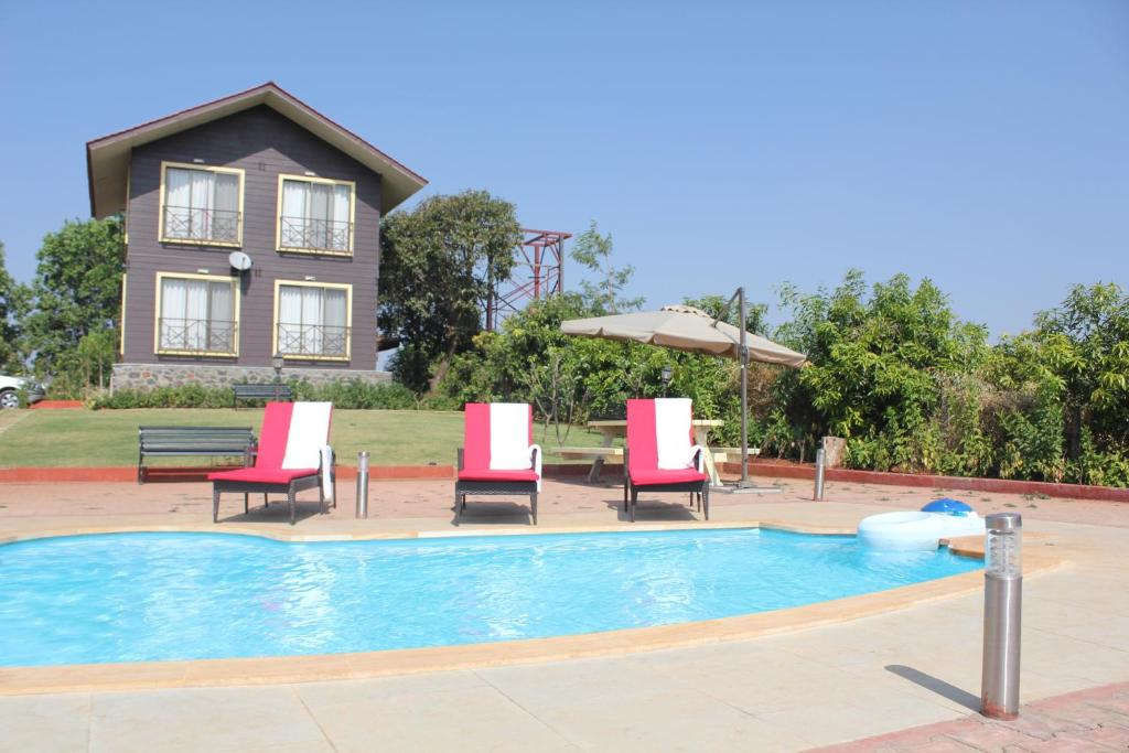 The swimming pool at or near JenJon Lake Vaitarna Resort