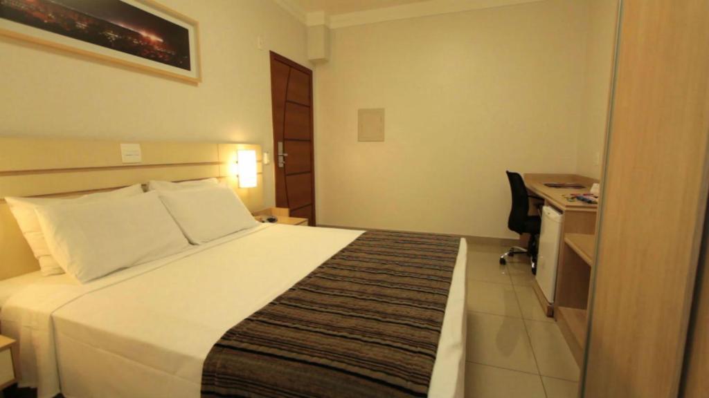 Cama ou camas em um quarto em Bristol Pampulha Lieu