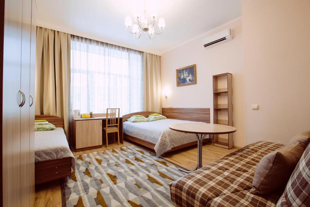 Кровать или кровати в номере Сити-отель