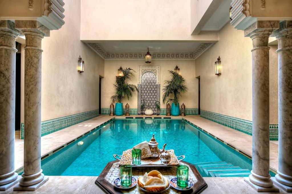 The swimming pool at or near Riad Kniza