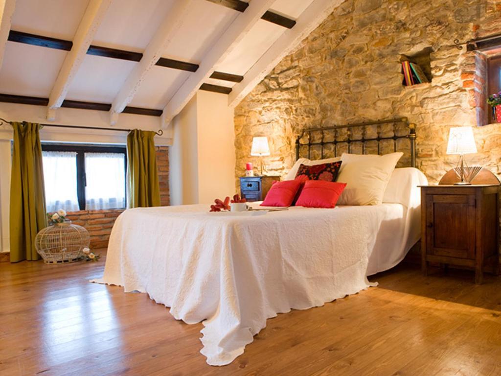 Cama o camas de una habitación en Posada Santa Ana