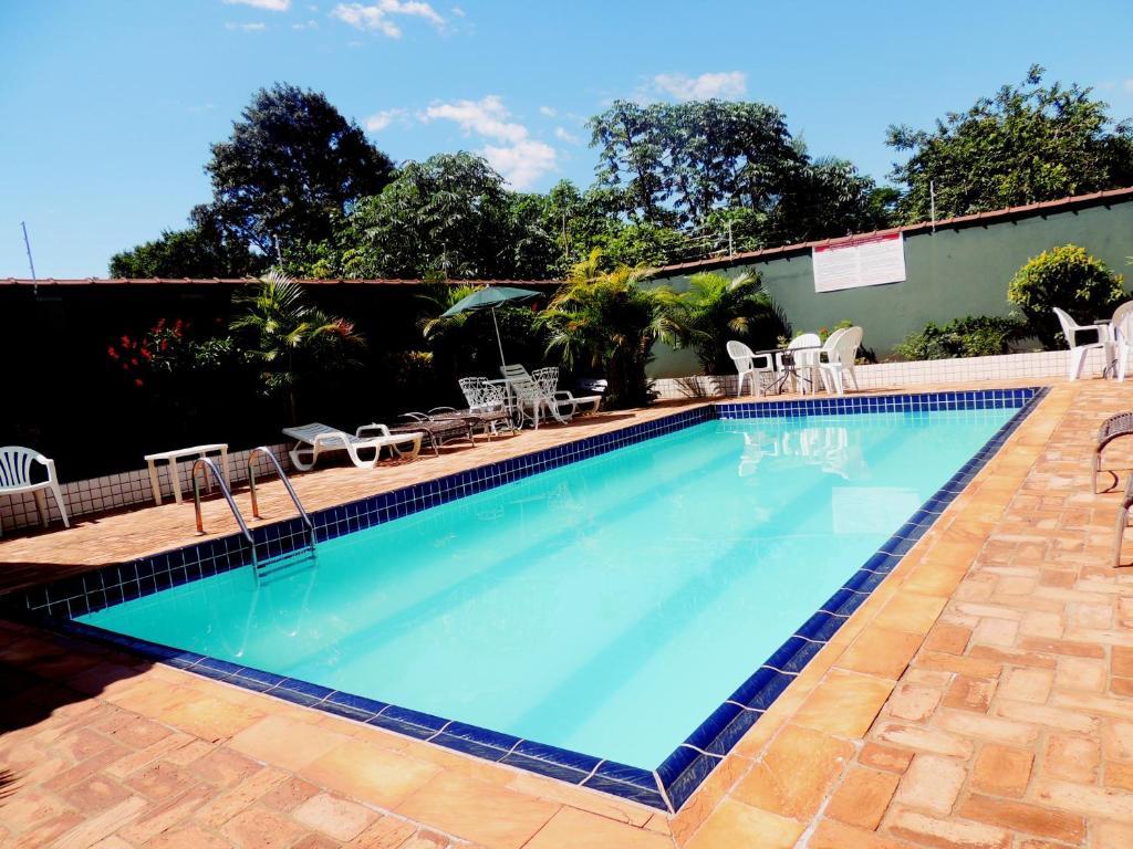 The swimming pool at or near Pousada Evelina