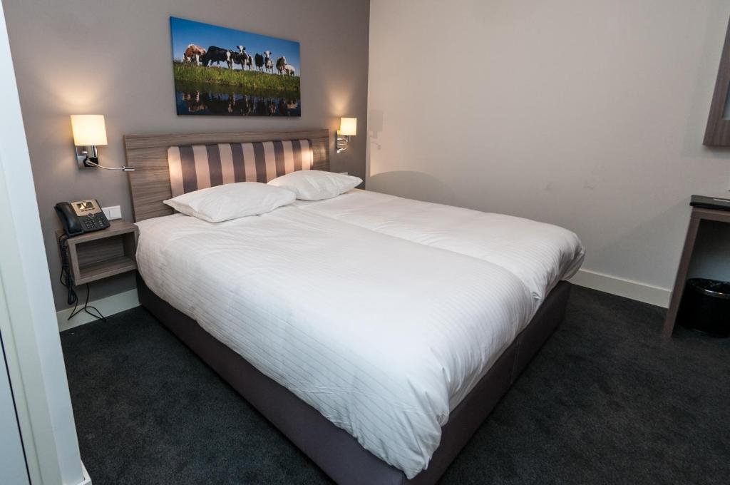 Un ou plusieurs lits dans un hébergement de l'établissement Hotel Fine Seasons