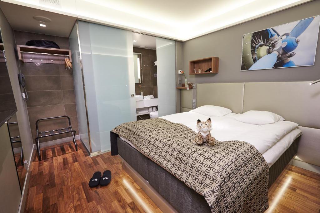 Säng eller sängar i ett rum på GLO Hotel Airport