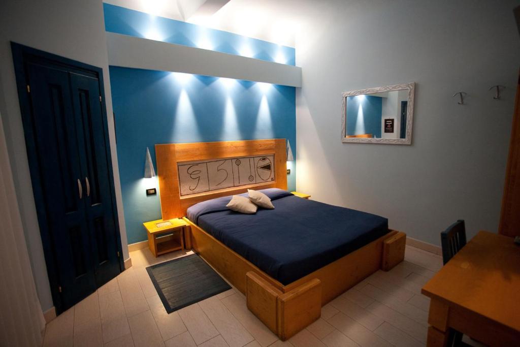 Letto o letti in una camera di Locanda dei Poeti Rooms & Apartments