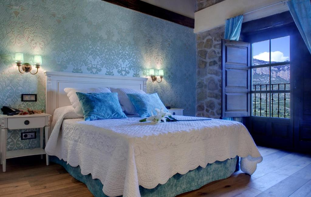 Cama o camas de una habitación en Hotel Real Posada De Liena
