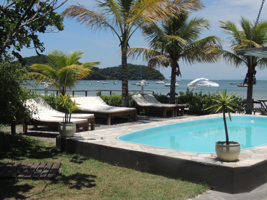 The swimming pool at or near Pousada Coração da Ilha