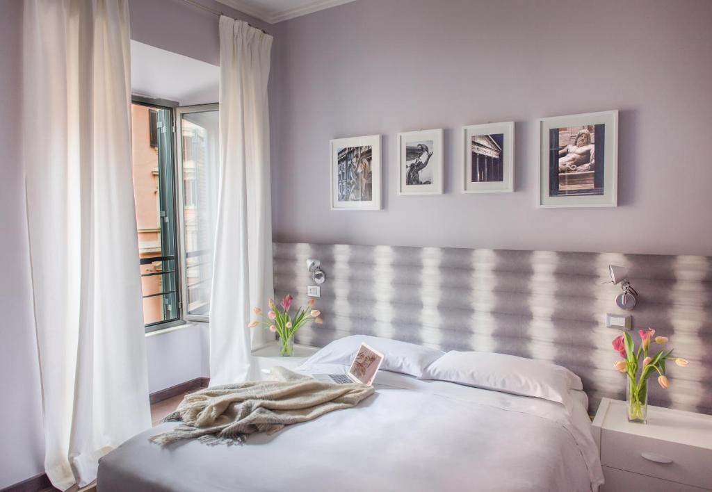 A bed or beds in a room at La Cupola del Vaticano