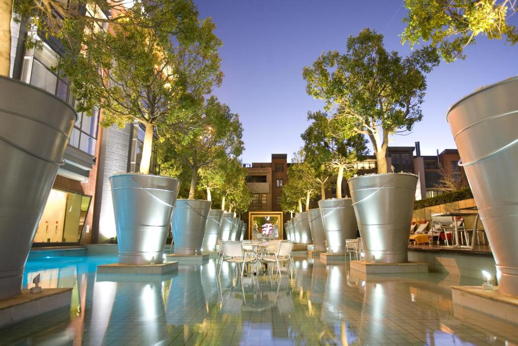The swimming pool at or near African Pride Melrose Arch, Autograph Collection