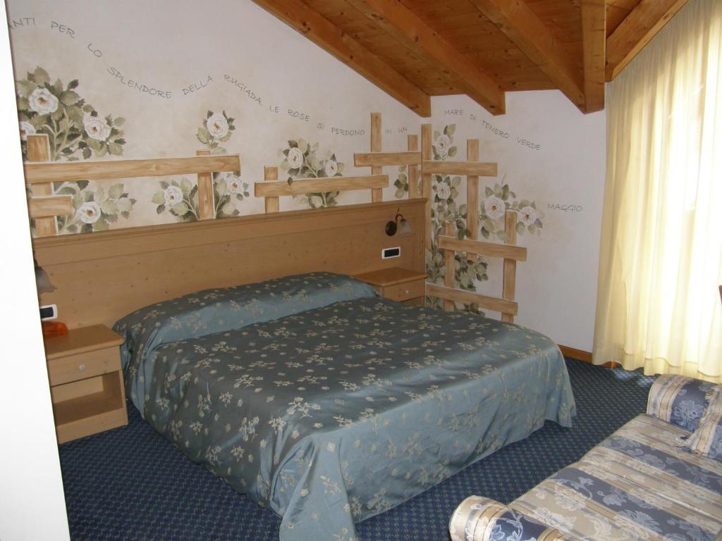 Letto o letti in una camera di Villa Ilaria